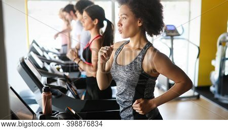 Group Of Fit Healthy Friends People Cardio Workout In Gym