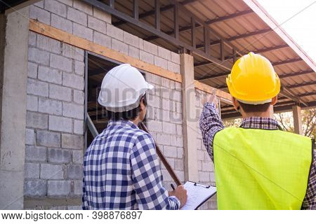 Team Of Engineers Or Inspectors Is Inspect The Structural Integrity And Construction Of The House Be