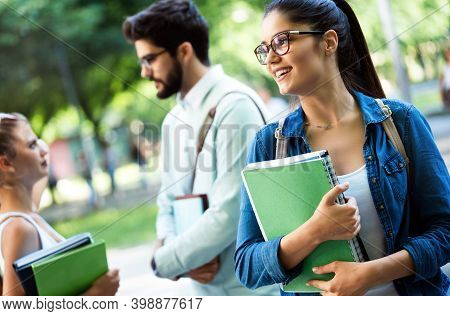 College Students Studying On University Campus Outdoor