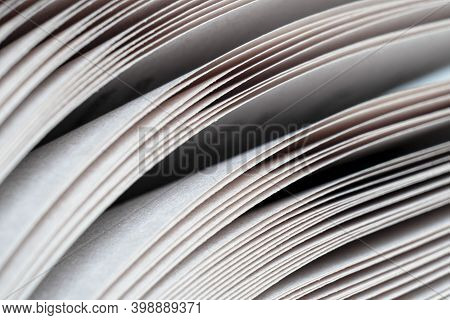 Macro Shot Of Open Book. Education And Study Concept. Close-up Of Opened Book Pages. Macro View Of B