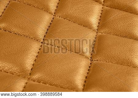 Modern Luxury Car Brown Leather Interior. Part Of Perforated Leather Car Seat Details. Orange Perfor