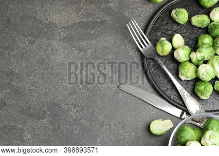 Fresh Brussels Sprouts On Grey Table, Flat Lay. Space For Text