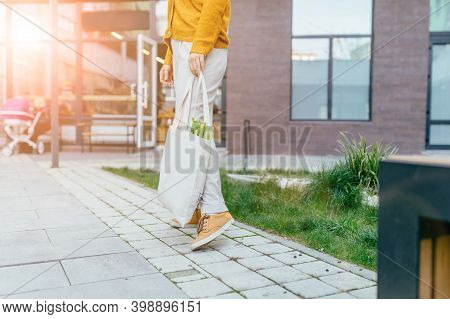 Unrecognizable Woman With White Cotton Bag In Her Hands. Zero Waste Concept With Sun Glare Effect Wo