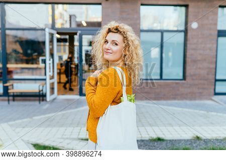 Zero Waste Concept With Copy Space. Woman Holding Cotton Shopper And Reusable Mesh Shopping Bags Wit