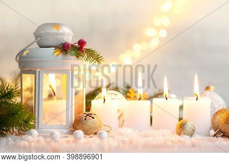 Christmas Decoration Lantern With A Candle And Four Burning Candle Lights At Christmas Eve. Backgrou