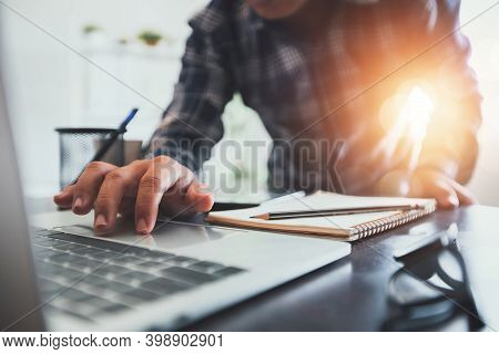 Close Up Hand Of Business Man Searching On Laptop And Using Computer To Find Information To Write On