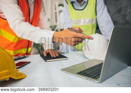 Two Businessman Planning And Analyzing In Financial Business, Explaining On Laptop And Checking Info