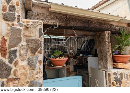 Nazareth, Israel, December 05, 2020 : The Pot With A Plant In A Suspension Made From A Bed From A Si