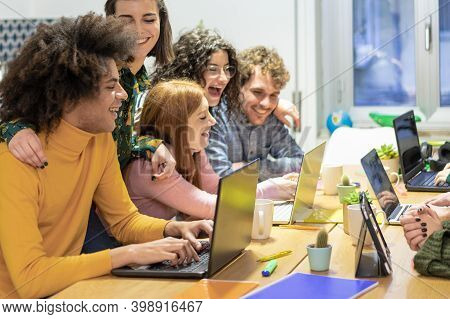 Young Teamwork Using Computer In The Apartment. Millennial People Working Together At New Project. Y