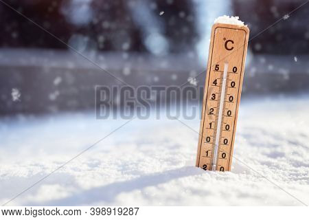Thermometer in the snow background with sub zero minus temperature concept for winter