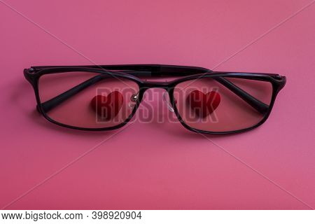 Hearts In Glasses On A Pink Background.