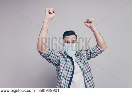 Portrait Of Nice Lucky Healthy Guy Wearing Safety Gauze Mask Having Fun Rejoicing Isolated Over Grey