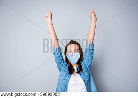 Portrait Of Nice Lucky Girl Wearing Safety Gauze Mask Celebrating Rising Hands Up Great Luck Isolate