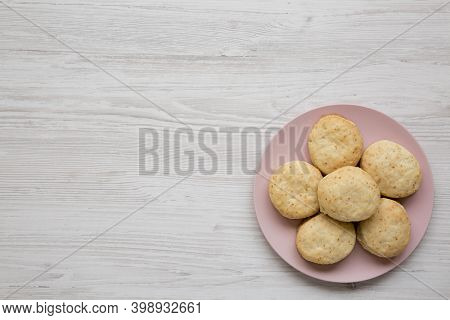 Homemade Flaky Buttermilk Biscuits On A Pink Plate On A White Wooden Background, Top View. Flat Lay,