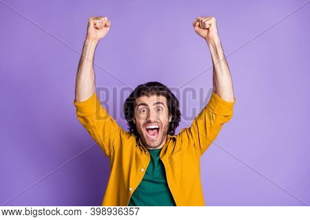 Photo Of Young Crazy Happy Triumphant Ecstatic Male Man Guy Raise Fists Shout Isolated On Purple Col