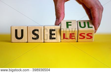 Useful Or Useless Symbol. Male Hand Turns Cubes And Changes The Word 'useless' To 'useful'. Beautifu