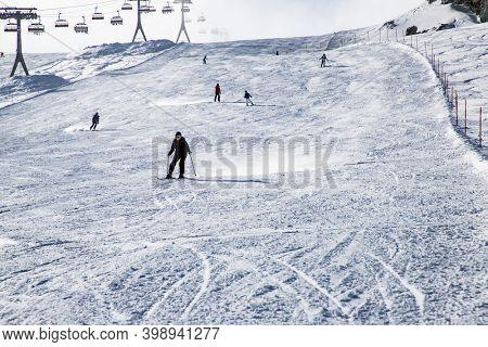 MATTERHORN GLACIER PARADISE, SWITZERLAND - JANUARY 2020: skiers in the Swiss Alps