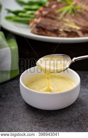 Bearnaise Sauce Made With Tarragon In A Small Bowl
