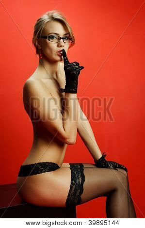 Attractive Young Woman With Her Finger Up