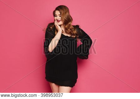 Plus Size Sexy Model Girl With Bright Makeup, Fashionable Blonde In Black Short Dress Posing At The