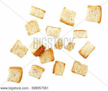 Wheat Square Croutons Croutons Falling On A White Background. Isolated