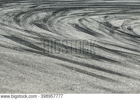 The Rubber Tracks From The Rallye Cars Left On The Tarmac In The Hairpin.