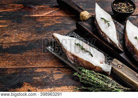 Raw Halibut Fish Steak. Dark Wooden Background. Top View. Copy Space