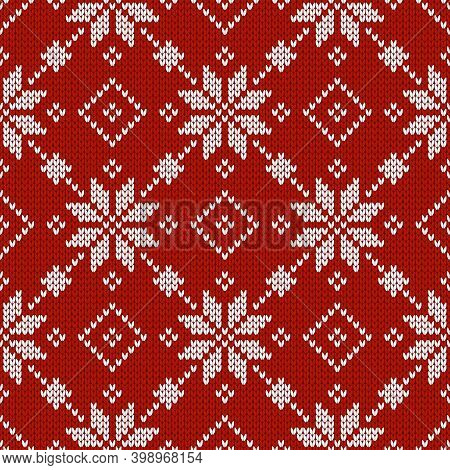 Christmas And New Year Traditional Knitted Seamless Pattern With Snowflakes. Norwegian Style Sweater