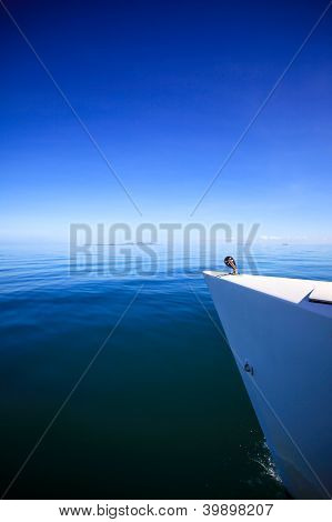 Bow of a sailing boat in calm blue sea