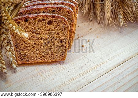 Delicious Bread. Fresh Loaf Of Rustic Traditional Bread With Wheat Grain Ear Or Spike Plant On Woode