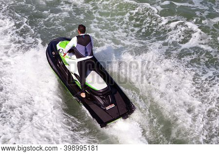 Overhead View Of A Man Riding On A Jetski.