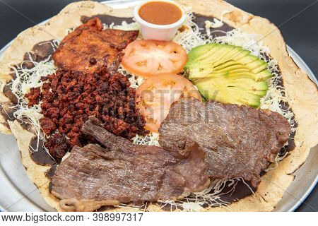 Sampler Taco Plate To Share With Family Including Carne Asada Steak, Hamburger, Pollo Chicken And Av