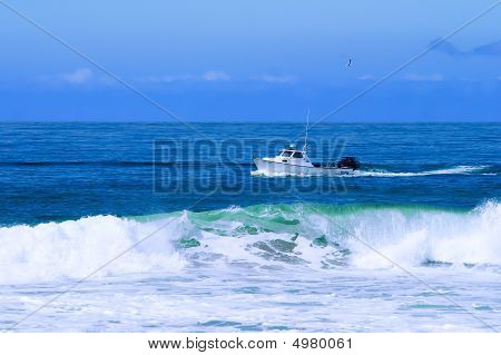 Fishing Boat Trawling For Fish And Checking Lobster Traps
