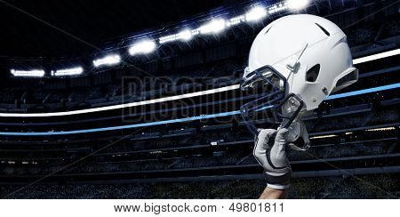 Raised Football Helmet at an American Football Stadium