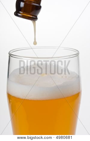 the last drop of wheat beer dripping a glass poster