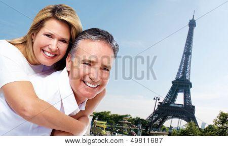 Senior couple near Eiffel tower. Tourism and traveling background.
