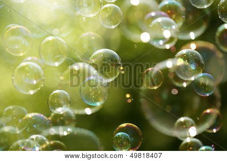Soap bubbles floating in the air as the Summer sun sets
