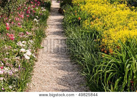 A walkway in Monet's garden Giverny France. A colorful symbol of adventure and exploraton. poster