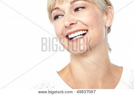 Closeup Shot Of A Beautiful Woman Smiling Heartily