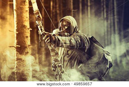 A Male Bow Hunter Wearing Gas Mask