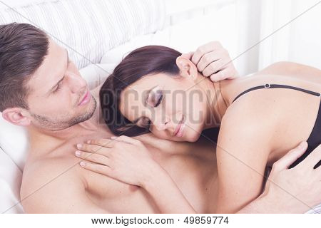 Young sexy heterosexual couple in the bed