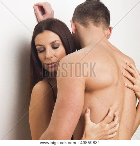 Young sexy heterosexual couple embracing