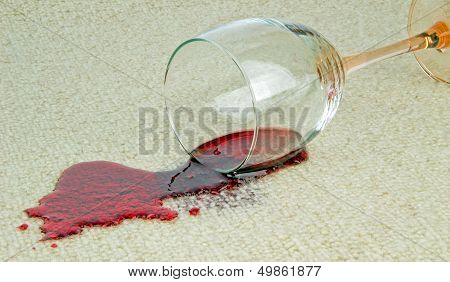 Spilled Galss of Wine on a Carpet
