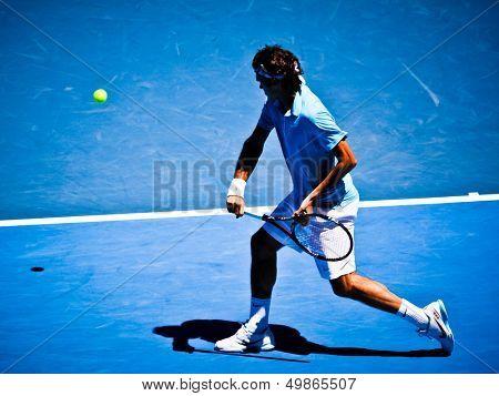 MELBOURNE, AUSTRALIA - JANUARY 25: Roger Federer inhis win over Lleyton Hewitt during the 2010 Australian Open on January 25, 2010 in Melbourne, Australia