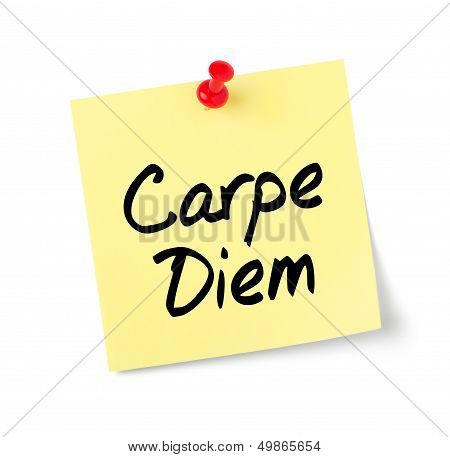 Yellow paper note with text Carpe Diem