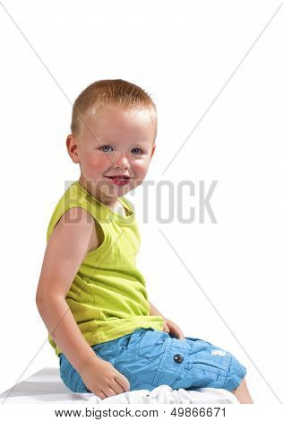 Preschooler Sitting Smiling On A White Background
