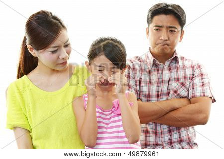 Parents scolding child