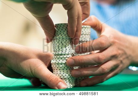 Hands Stacking Poker Chips