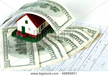 Family house with money and contract. Real estate background.