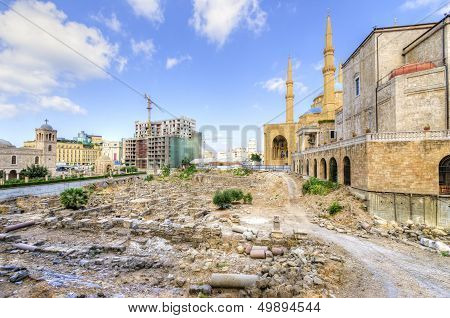 A view of the Saint George Maronite Cathedral and the Mohammad Al-Amin Mosque at the historic centre of Beirut in Lebanon. Beautiful and picturesque religious architecture in the centre of Beirut Downtown. poster